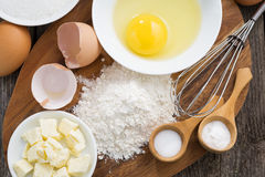 Prepared fresh baking ingredients on a wooden board, horizontal Royalty Free Stock Photo