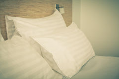 Prepared fresh bed, scene in hotel room Royalty Free Stock Photos