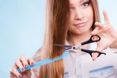 Prepared girl to cut her long straight hair. Royalty Free Stock Photos