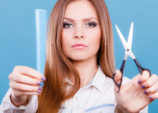 Prepared girl to cut her long straight hair. Royalty Free Stock Image