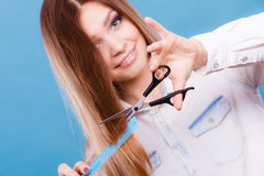 Prepared girl to cut her long straight hair. Royalty Free Stock Photography