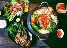 Prepared hot pot of beef with chili, mushroom, herbs, lemongrass Royalty Free Stock Photos
