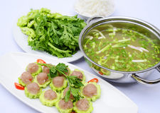Prepared hot pot of fish ball with bitter melon on white platter stock images