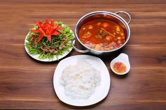 Prepared hot pot of seafood in Thai style with vermicelli, fish Stock Photos