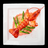 Prepared lobster isolated on black Stock Images