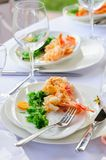Prepared lobster on plate. Prepared lobster and sea weed served on plates Royalty Free Stock Photo
