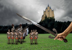 Prepared for medieval battle. Hand with sword raised and ready for battle medieval Stock Image