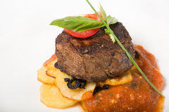 Prepared mignon steak. With potato garnish and sauce royalty free stock images