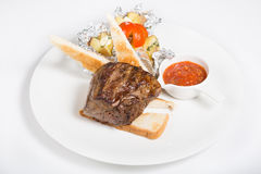 Prepared mignon steak. Served with croutons and sauce royalty free stock photo