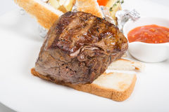 Prepared mignon steak. Served with croutons and sauce stock photography