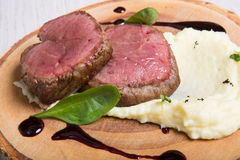 Prepared mignon steak. Served with mashed potato stock photography
