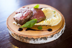 Prepared mignon steak. Served with mashed potato royalty free stock images