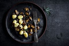Ingredients for preparing mushrooms and gnocchi dish Royalty Free Stock Images