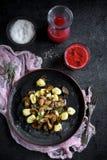 Ingredients for preparing mushrooms and gnocchi dish Stock Images