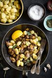Ingredients for preparing mushrooms and gnocchi dish Stock Photo