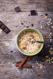 Prepared oatmeal on old wooden table Stock Photos