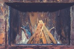 Furnace home. Prepared pile of firewood in old home furnace. Rustic colorful fireplace without fire Royalty Free Stock Photography