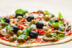 Prepared pizza before baking Royalty Free Stock Images