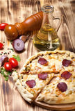 Prepared pizza with smelted cheese Stock Photo