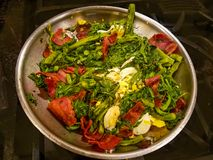 Prepared Polk Salat with eggs and bacon in metal bowl royalty free stock photography