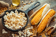 Prepared Popcorn In Frying Pan, Corn Seeds And Corncobs Royalty Free Stock Image
