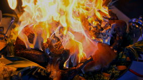 Prepared pork with fire flames at wedding ceremony. stock footage