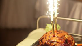 Prepared pork with sparklers at wedding ceremony stock video footage