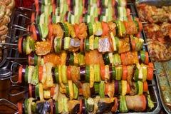 Prepared raw skewers of seafood Stock Images
