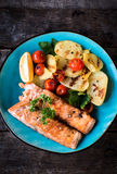Prepared salmon fish. And grilled vegetables in the plate,selective focus Royalty Free Stock Photography