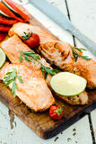 Prepared salmon fish. On wooden board,selective focus Stock Photography
