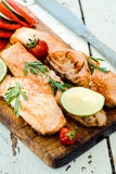 Prepared salmon fish. On wooden board,selective focus Royalty Free Stock Photos