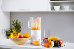 Prepared smoothies and healthy smoothie ingredients in blender w Royalty Free Stock Image