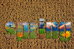 Prepared soil with colorful spring images inside the word spring Royalty Free Stock Image