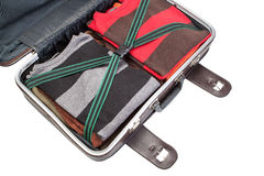 Prepared suitcase  in holiday trip. Close up on white background. Stock Photo