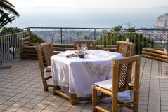 Prepared for supper table on the terrace overlooking the Bay of Naples and Vesuvius. Sorrento. Italy Royalty Free Stock Image