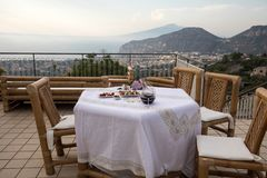 Prepared for supper table on the terrace overlooking the Bay of Naples and  Vesuvius. Sorrento. Italy Royalty Free Stock Images