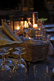Prepared table for a rustic outdoor dinner at night Royalty Free Stock Images