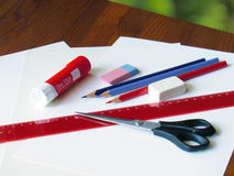 Prepared to work office supplies. On wooden table Royalty Free Stock Photos