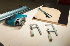 Prepared tool jigsaw with wood clamps and a pencil with a ruler lying Stock Photo