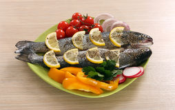 Prepared trout with lemon and salad Stock Image
