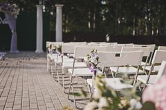 Prepared for the wedding ceremony space to accommodate spectator. Guests in the summer cafe Royalty Free Stock Photos