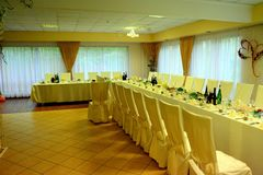Prepared wedding party table in village room Stock Photo