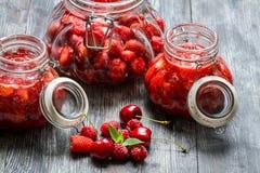 Prepared of wild strawberry compote Stock Photos