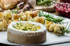 Prepareing for Baked Camembert with Garlic & Rosemary Stock Photos
