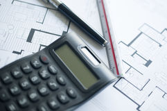 Prepares the architectural floorplan for a residence Stock Photos