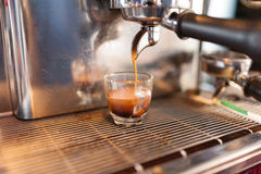 Prepares coffee. With the machine in Coffee shop Stock Photography