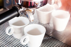 Prepares espresso in  coffee shop with vintage filter style Royalty Free Stock Photo