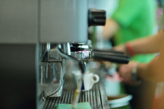 Prepares espresso in his coffee shop, close-up royalty free stock images