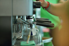 Prepares espresso in his coffee shop, close-up royalty free stock photography