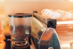 Coffee extraction from professional coffee machine, grinder closeup. Coffee shop closeup royalty free stock photos